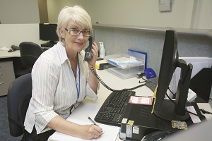 Photograph of employee talking on phone