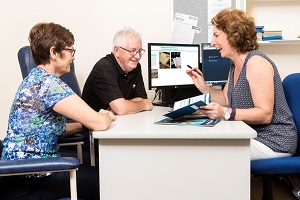 Photo of staff member discussing a resource with a patient