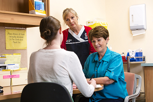 Photo of staff talking with patient